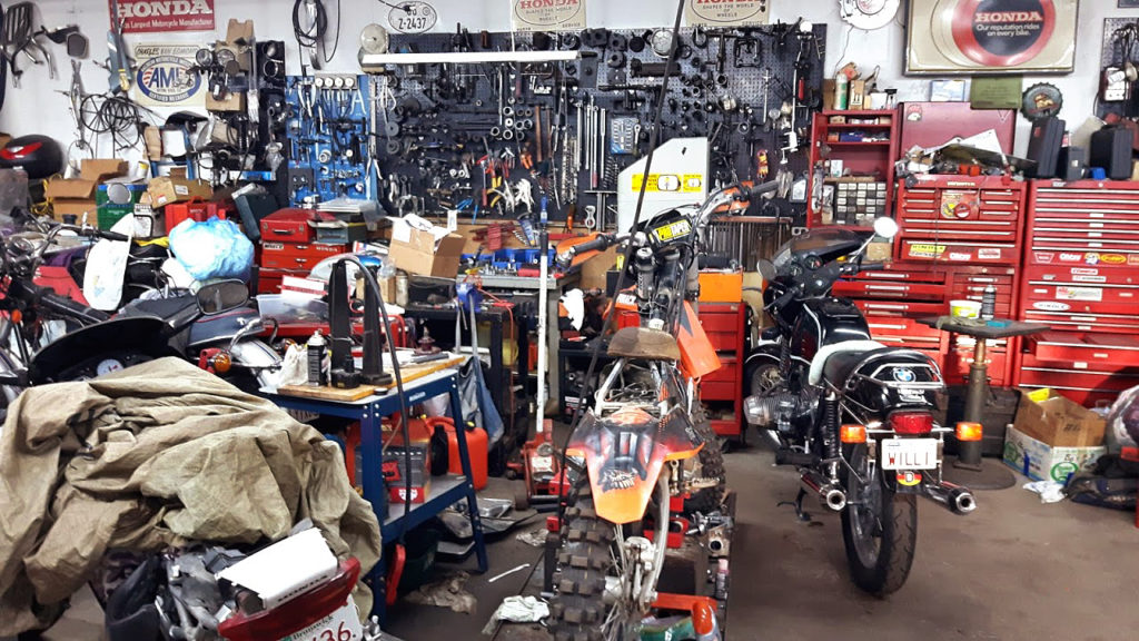 Motorcycle garage with various parts and tools