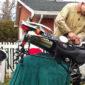 working on bike maintenance in own backyard